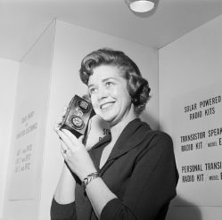 Donna Johnson listens to a solar-cell-powered transistor radio at a Hobby Industry Association of America show in Chicago. A flick of the switch changes the radio operation from solar power to pen light batteries. February 5, 1963. February 5, 1963 Chicago, Illinois, USA